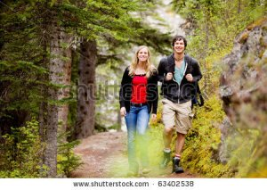 stock-photo-a-happy-man-and-woman-hiking-on-a-camping-trip-63402538